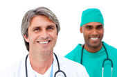 Smiling male doctors standing in a line — Stock Photo