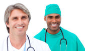 Charismatic male doctors standing in a line — Stock Photo