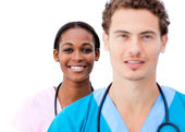 Portrait of young doctors standing in a row — Stock Photo
