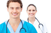 Attractive doctors standing in a row — Stock Photo