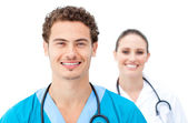 Self-assured doctors standing in a row — Stock Photo