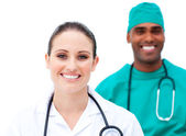 Charismatic doctors standing in a row — Stock Photo