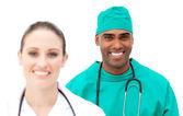 Multi-ethnic doctors standing in a row — Stock Photo