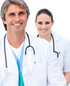 Two smiling doctors looking at the camera — Stock Photo