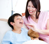 Cheerful little boy attending a medical exam — Stock Photo