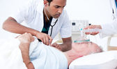 Serious doctor resuscitating a patient — Stock Photo