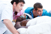 Concentrated medical team resuscitating a patient — Stock Photo