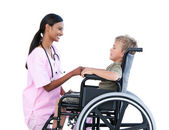 Ciute little boy in a wheelchair discussing with his doctor — Stock Photo