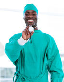 Smiling male doctor holding a stethoscope — Stock Photo