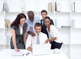 Business team working together with a laptop — Stock Photo