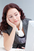 Young businesswoman in office getting bored — Stock Photo