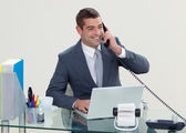 Manager on phone in his office — Stock Photo