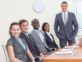 Businessteam in a meeting analyzing profits and taxes — Stock Photo