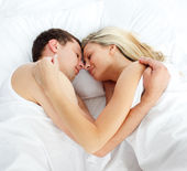 Boyfriend and girlfriend sleeping in bed — Stock Photo