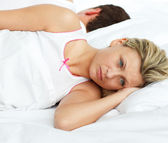 Upset couple in bed sleeping separate — Stock Photo