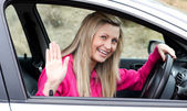 Joyful young female driver at the wheel — Foto Stock