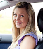 Portrait of a smiling young female driver — Foto Stock