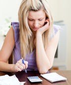 Stressed woman paying her bills — Stock Photo