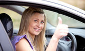 Smiling female driver with thumb up — Foto Stock