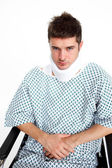 Man with a neck brace in hospital — Stock Photo