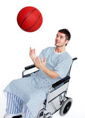 Patient in wheelchair having fun with a basket ball — Stock Photo