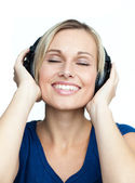Close-up of woman listening to music with headphones on — Stock Photo