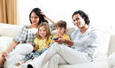 Smiling family watching TV — Stock Photo