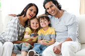 Happy family watching TV together sitting — Stock Photo