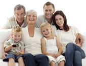 Happy family watching television in living-room — Stock Photo