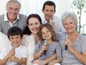 Portrait of family singing in living-room — Stock Photo