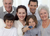 Family watching television at home — Stock Photo