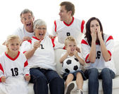 Family watching a football match in television — Stock Photo