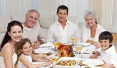 Family having a dinner together at home — ストック写真