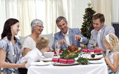 Family eating turkey in Christmas Eve — Stock Photo