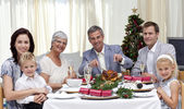 Family eating turkey in Christmas Eve Dinner — Stock Photo