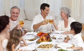 Parents and grandparents tusting with wine in a dinner — Stock Photo