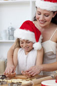 Mãe e filha bolos natal — Fotografia Stock
