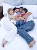 High view of parents and children relaxing in bed — Stock Photo