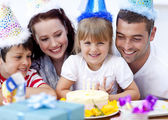 Parents and children celebrating a birthday — Stock Photo