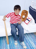 Little boy playing baseball in bed — Stock Photo
