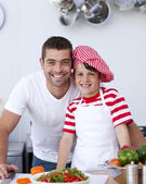 Father and son cooking a salad — Stock Photo