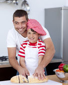 Father and son cutting bread — Stock Photo