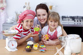 Mother baking with children in the kitchen — Stock Photo