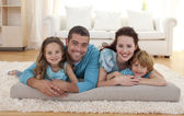 Family on floor in living-room — Stock Photo