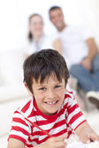 Smiling kid painting on floor in living-room — Stock Photo