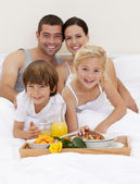 Family having breakfast in bedroom — Stock Photo
