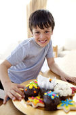 Happy boy eating colorful confectionery — Stock Photo