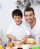 Smiling father and son preparing a toast — Stock Photo