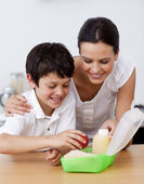 Mother and son making the school lunch — Stock Photo