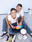 High angle of couple chosing colours to paint new house — Stock Photo